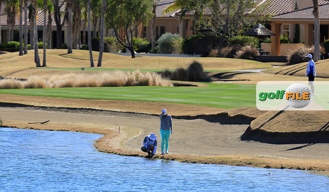 Danny Lee (NZL) takes a penalty drop after ending up in the water on the 18th hole during Saturday's Round 3 of the 2017 CareerBuilder Challenge held at PGA West, La Quinta, Palm Springs, California, USA.<br /> 21st January 2017.<br /> Picture: Eoin Clarke | Golffile<br /> <br /> <br /> All photos usage must carry mandatory copyright credit (&copy; Golffile | Eoin Clarke)