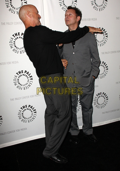TERRY O'QUINN & MICHAEL EMERSON.27th Annual PaleyFest Presents the television show 'Lost' held At The Saban Theatre, Beverly Hills, California, USA, 27th February 2010..arrivals full length black grey gray suit shirt trousers top sweater jumper side hand arm funny .CAP/ADM/KB.©Kevan Brooks/Admedia/Capital Pictures