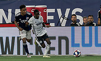FOXBOROUGH, MA - JUNE 27: Jamiro Monteiro #35 attempts to control the ball as Juan Agudelo #17 closes during a game between Philadelphia Union and New England Revolution at Gillette Stadium on June 27, 2019 in Foxborough, Massachusetts.