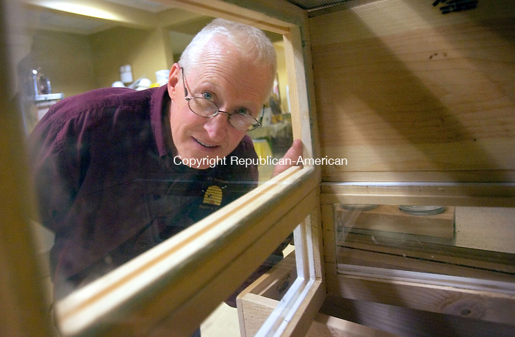 WOODBURY CT. 18 January 2014-011814SV07-Mike Rice of Roxbury sells his homemade beehive boxes at Beekeeping School at the Woodbury Senior Center in Woodbury Saturday.<br /> Steven Valenti Republican-American