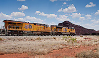 Trains are still hauling large amounts of frieght next to Route 66 near Newkirk New Mexico.