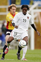 The MetroStars' Fabian Taylor is marked by Kelly Gray of the Fire. The MetroStars defeated the Chicago Fire 2-0 during the inaugural Hall of Fame game on Monday October 11, 2004 at At-A-Glance Field at the National Soccer Hall of Fame and Museum, Oneonta, NY..
