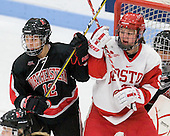 Sonia St. Martin (NU - 12), Jenn Wakefield (BU - 9) - The Boston University Terriers defeated the visiting Northeastern University Huskies 3-0 on Tuesday, December 7, 2010, at Walter Brown Arena in Boston, Massachusetts.