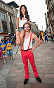 Miss Scotland 2013, Jamey Bowers, gets a lift from a street performer as the Glasgow 2014 Commonwealth Games 1 year countdown begins.