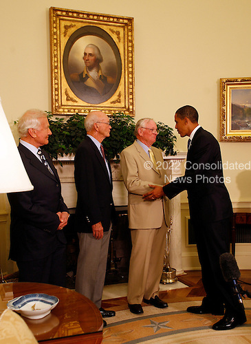 """Washington, DC - July 20, 2009 -- United States President Barack Obama meets with Apollo 11 crew members (l-r) Edwin Eugene """"Buzz"""" Aldrin, Jr., Michael Collins, and Neil Armstrong in the Oval Office of the White House on the 40th anniversary of the astronauts' lunar landing, Washington, DC, Monday, July 20, 2009. .Credit: Martin H. Simon / Pool via CNP"""