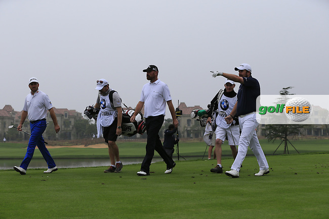 Graeme McDowell (NIR), Thomas Bjorn (DEN) and Shane Lowry (IRL) walk off the 6th tee during Saturay's Round 3 of the 2014 BMW Masters held at Lake Malaren, Shanghai, China. 1st November 2014.<br /> Picture: Eoin Clarke www.golffile.ie