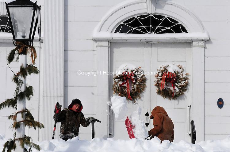 WOODBURY CT, 09 FEB 13-020913AJ07- Joey Geraci and Mike Sibilia clear snow at North Congregational Church in Woodbury Saturday morning.     Alec Johnson/ Republican-American