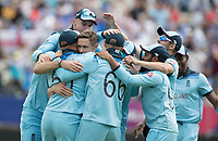 Chris Woakes (England) is mobbed by team mates following the wicket of David Warner during Australia vs England, ICC World Cup Semi-Final Cricket at Edgbaston Stadium on 11th July 2019
