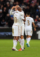 Jonjo Shelvey of Swansea celebrates his goal he scored with a penalty kick, with co-scorer Andre Ayew during the Barclays Premier League match between Swansea City and Bournemouth at the Liberty Stadium, Swansea on November 21 2015