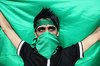 A young man wearing green, the colour of the opposition. An estimated one million people formed a human chain along Vali asr Avenue, the longest street in Tehran. Following a disputed election result, thousands of supporters of opposition candidate Mir-Hossein Mousavi took to the streets in protest.