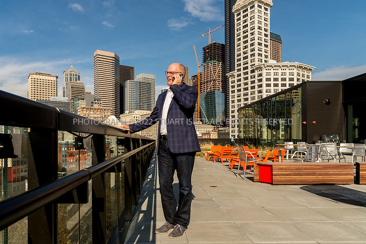 11/4/2016-- Seattle, WA, USA<br /> <br /> Bill LaPatra, a partner at Mithun Architects, on the roof top of the new Weyerhaeuser's headquarters he designed in Seattle.<br /> <br /> Weyerhaeuser&rsquo;s new Seattle headquarters in Pioneer Square, designed by architect Bill LaPatra, a partner at Mithun Architects, a firm well-known for its emphasis on sustainability.<br /> <br /> The building is unusual, because it is almost self-effacing, with the front door opening onto a park-courtyard area, with the building almost hidden behind a line of mature trees. Despite its quiet appearance, this is headquarters for Weyerhaeuser, a major corporate employer.<br /> <br /> Photograph by Stuart Isett. &copy;2016 Stuart Isett. All rights reserved.