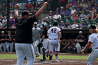 With Jefferson City head coach Brian Ash raising his arms in victory (left), Gunnar See steps on homeplate to score the winning run after Jacob Weirich was hit by a pitch with the bases loaded in the bottom of the eighth-inning, giving the Jays the Class 5 State Championship.
