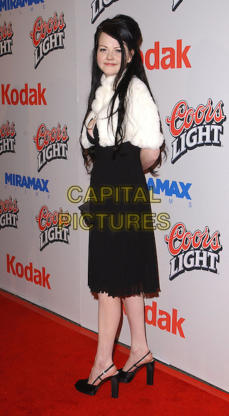 MEG WHITE - THE WHITE STRIPES.The Cold Mountain L.A. Premiere held at The Mann National Theater in Westwood, California .07 December 2003.full length, full-length, black dress, shoes, white fur shawl, pashmina.www.capitalpictures.com.sales@capitalpictures.com.©Capital Pictures.