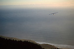 Hang glider over Pacific Ocean and Stinson Beach, from Mount Tamalpais, Marin County, California