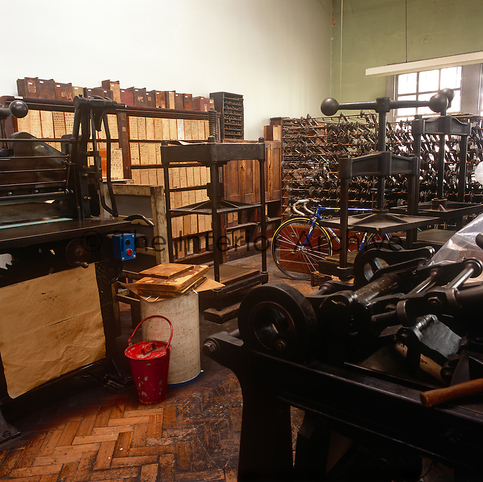 The interior of George Bayntun, one of the world's most famous bookshops and home to the Bayntun-Riviere bindery, which dates back to 1829. Tools and machinery in the bindery.