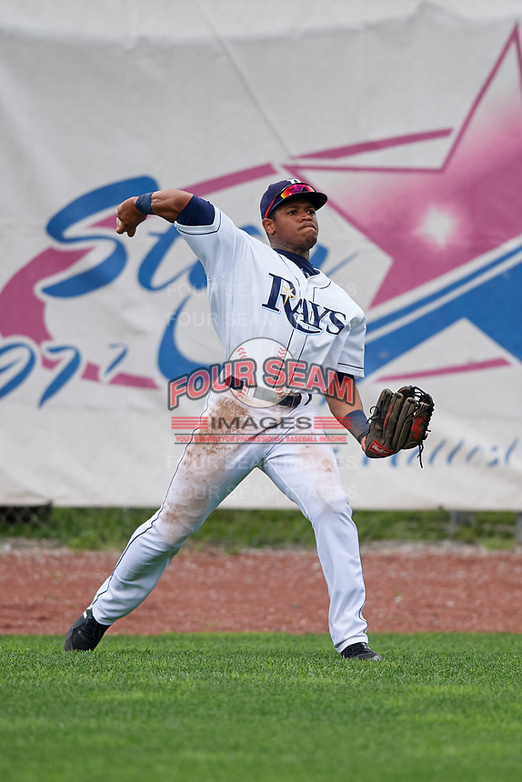 Princeton Rays left fielder Pedro Diaz (30) throws from the outfield during the first game of a doubleheader against the Greeneville Reds on July 25, 2018 at Hunnicutt Field in Princeton, West Virginia.  Princeton defeated Greeneville 6-4.  (Mike Janes/Four Seam Images)