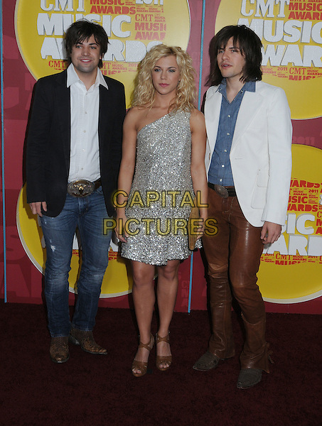 Neil Perry, Kimberly Perry, Reid Perry of The Band Perry.2011 CMT Music Awards held at Bridgestone Arena, Nashville, Tennessee, USA..June 8th, 2011.full length silver dress black suit jacket white shirt brown leather trousers one shoulder .CAP/ADM/LF.©Laura Farr/AdMedia/Capital Pictures.