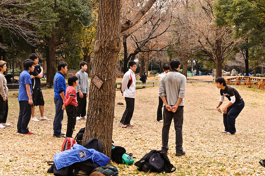 "Parkour coach Jun ""Sullivan Sato"" with students. Parkour Tokyo group practice, Shinjuku Chuo Koen, Tokyo, Japan, January 15, 2012. Parkour is a modern method of physical training, also known as freerunning. It was founded in France in the 1990s. There is a small group of around 50 parkour practitioners in Tokyo."