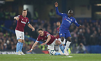 West Ham United's Javier Hernandez is challenged by Chelsea's Ngolo Kante<br /> <br /> Photographer Rob Newell/CameraSport<br /> <br /> The Premier League - Chelsea v West Ham United - Monday 8th April 2019 - Stamford Bridge - London<br /> <br /> World Copyright &copy; 2019 CameraSport. All rights reserved. 43 Linden Ave. Countesthorpe. Leicester. England. LE8 5PG - Tel: +44 (0) 116 277 4147 - admin@camerasport.com - www.camerasport.com