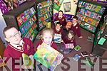 BOOK FAIR: Children from Holy Family National School were delighted with the huge book choice at the book fair in their school last week. From front l-r were: Robbie Enright and Amanda Porojan. Pictured at the back were: Rian McLysaght,  Norella Quirke, Tommy Lynch and Shane Dunne.