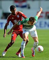 Fussball 1. Bundesliga :  Saison   2012/2013   1. Spieltag  25.08.2012 SpVgg Greuther Fuerth - FC Bayern Muenchen Jerome Boateng (li, FC Bayern Muenchen) gegen Felix Klaus (Greuther Fuerth)