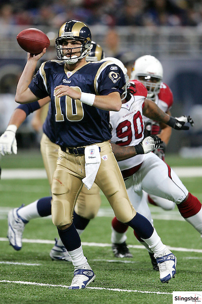 St. Louis Rams quarterback Marc Bulger scrambles out of the pocket while looking for a reciever downfield versus the Arizona Cardinals, Dec. 3, 2006, at the Edward Jones Dome, in St. Louis, MO.  The Cardinals won the game 34-20.