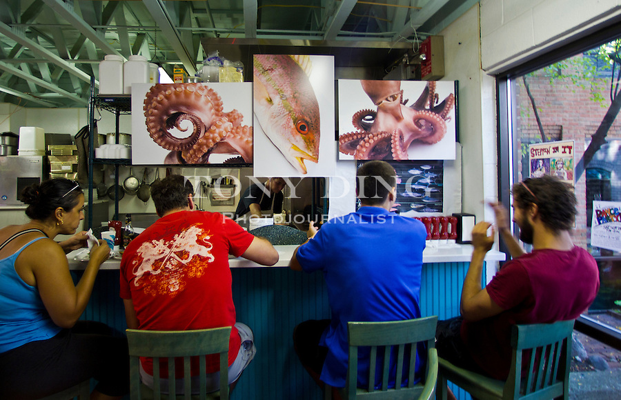Monahan's Seafood lunch counter, Friday, Sept. 2, 2011 in Ann Arbor, Mich. (Tony Ding for The New York Times)