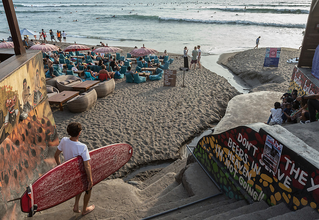 6 DECEMBER, 2019 BALI, INDONESIA: A surfer heads down for a wave at Old Man's in Canggu, Bali. There has been a levelling out of Australian tourist numbers to Bali in recent times and tastes are changing regarding what people want from their holiday. Millennials are being targeted by tourism authorities and they want to give them more boutique experiences than just beach and beer. Picture by Graham Crouch/The Australian