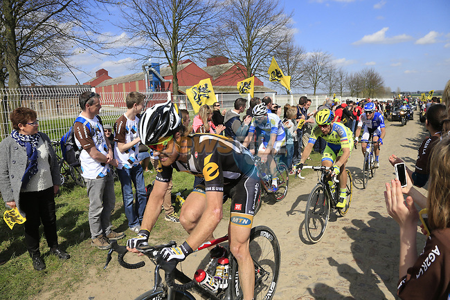 The peloton including Tyler Farrar (USA) MTN Qhubeka tackle Sector 10 Mons-en-Pevele during the 113th edition of the Paris-Roubaix 2015 cycle race held over the cobbled roads of Northern France. 12th April 2015.<br /> Photo: Eoin Clarke www.newsfile.ie