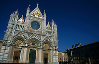 Ornate and decorative exterior of the Cathedral of Siena, Siena, Italy.