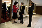 March 17, 2009. Raleigh, NC.. Images from one day in the life of Deborah K. Ross, Representative for North Carolina House District 38.. 10:54 AM. Ross stops in the hallway of the legislature to talk to staff and colleagues on her way to a meeting of the education committee..Her intern, Jezzette Rivera, right, follows along.