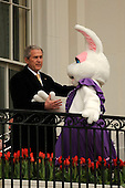 United States President George W. Bush, left, greets Mrs. Bunny after welcoming participants to the annual White House Easter Egg Roll March 24, 2008 on the South Lawn of the White House in Washington, DC. The Easter Egg Roll is a traditional all-American event held on the White House lawn each year since 1878, where kids compete by using a giant wooden spoon to push and egg. <br /> Credit: Ken Cedeno / Pool via CNP