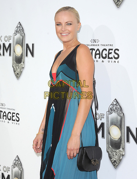 "Malin Akerman.""The Book of Mormon"" Hollywood Opening night Held At The Pantages theatre, Hollywood, California, USA..September 12th, 2012.half length black blue green teal maxi dress sleeveless red side bag purse satchel side .CAP/DVS.©DVS/Capital Pictures."