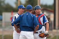 26 july 2010: Anthony Piquet of France talks to pitching coach Jeff Zeilstra and catcher Boris Marche as he pitches against Ukraine during France 10-2 victory over Ukraine, in day 4 of the 2010 European Championship Seniors, in Neuenburg, Germany.