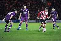 Lincoln City's Shay McCartan seeks a way past Carlisle United's Jack Sowerby, left, and Anthony Gerrard, centre<br /> <br /> Photographer Andrew Vaughan/CameraSport<br /> <br /> The Emirates FA Cup Second Round - Lincoln City v Carlisle United - Saturday 1st December 2018 - Sincil Bank - Lincoln<br />  <br /> World Copyright © 2018 CameraSport. All rights reserved. 43 Linden Ave. Countesthorpe. Leicester. England. LE8 5PG - Tel: +44 (0) 116 277 4147 - admin@camerasport.com - www.camerasport.com