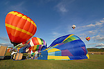 Hot air balloons take flight as they are inflated during the Rotary Festival Saturday at the Lycoming County Fairgrounds.