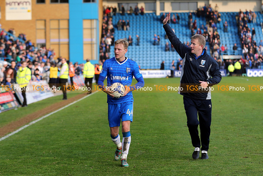 Gillingham's Josh Wright walks off the pitch with the match ball after scoring three goals as Gillingham's Manager, Ady Pennock waves at the home fans during Gillingham vs Scunthorpe United, Sky Bet EFL League 1 Football at the MEMS Priestfield Stadium on 11th March 2017