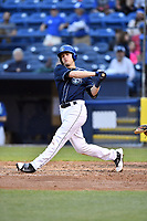 Asheville Tourists first baseman Tyler Nevin (23) swings at a pitch during a game against the Greensboro Grasshoppers at McCormick Field on April 27, 2017 in Asheville, North Carolina. The Tourists defeated the Grasshoppers 8-5. (Tony Farlow/Four Seam Images)