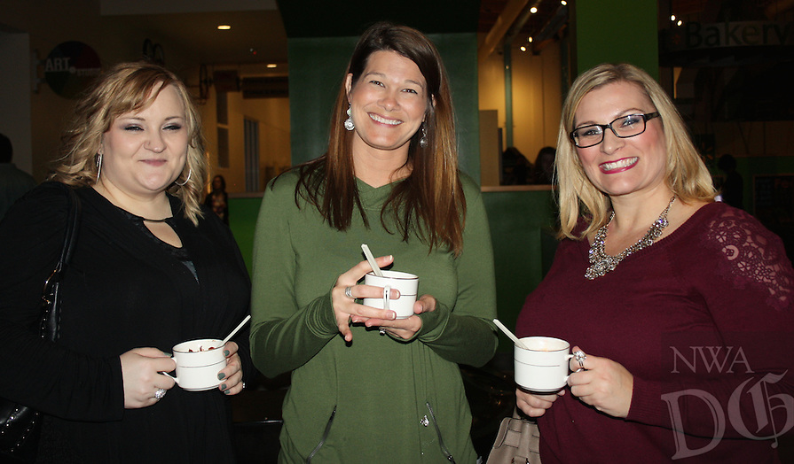 NWA Democrat-Gazette/CARIN SCHOPPMEYER Tausha Lawrey (from left), Kym Graves and Tesa Patterson enjoy their creations from the hot chocolate bar at HEAT.