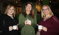NWA Democrat-Gazette/CARIN SCHOPPMEYER Tausha Lawrey (from left), Kym Graves and Tesa Patterson enjoy their creations from the hot chocolate bar at HEAT.