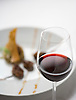 A glass of Rioja wine with cheeks of lamb at the Venta Moncalvillo restaurant. Photo by Kevin J. Miyazaki/Redux