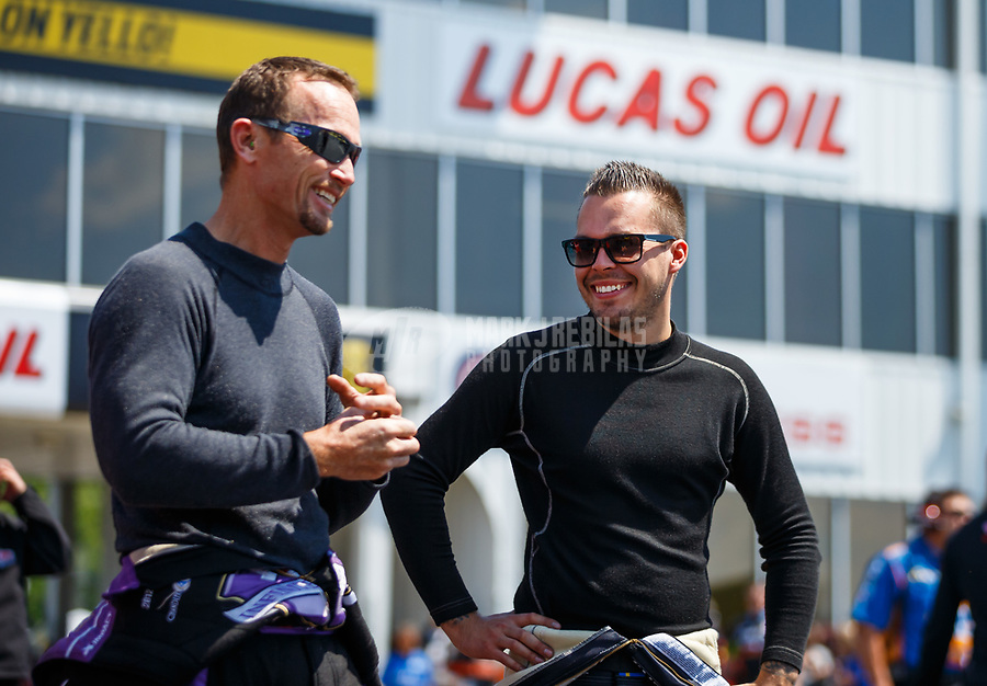 May 6, 2017; Commerce, GA, USA; NHRA funny car driver Jonnie Lindberg (right) talks with Jack Beckman during qualifying for the Southern Nationals at Atlanta Dragway. Mandatory Credit: Mark J. Rebilas-USA TODAY Sports