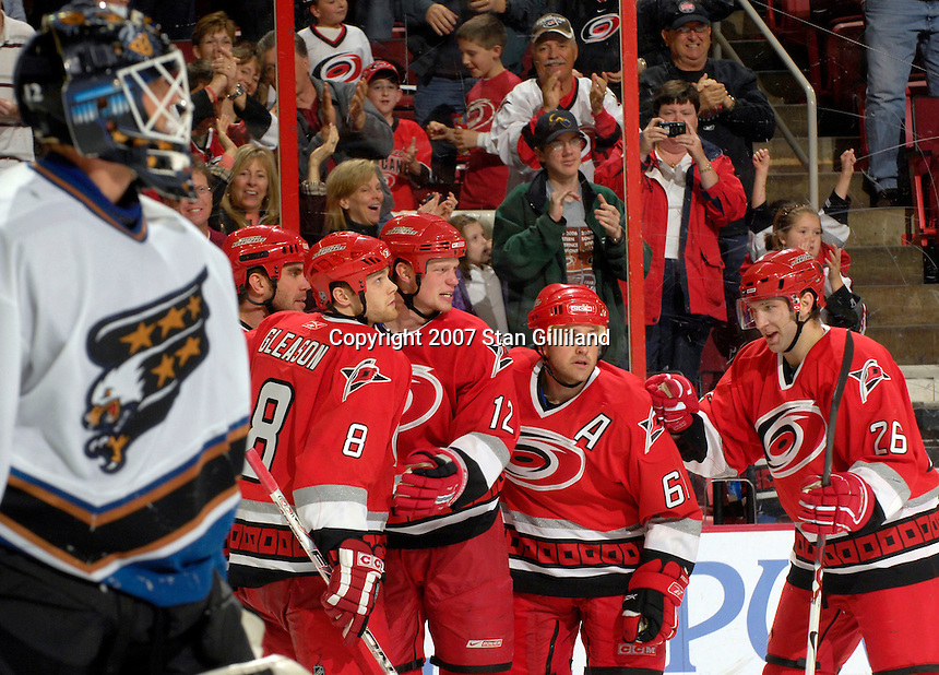 Carolina Hurricanes' Eric Staal celbrates his goal with teammates (left to right) Niclas Wallin, Tim Gleason, Cory Stillman (61) and Erik Cole as the Washington Capitals' goalie Brent Johnson looks on Thursday, March 22, 2007 at the RBC Center in Raleigh, NC. Carolina won 4-3.