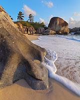 Virgin Gorda, British Virgin Islands, Caribbean<br /> Evening light illuminates  wave-sculpted rocks on the beach of Little Trunk Bay near the Baths