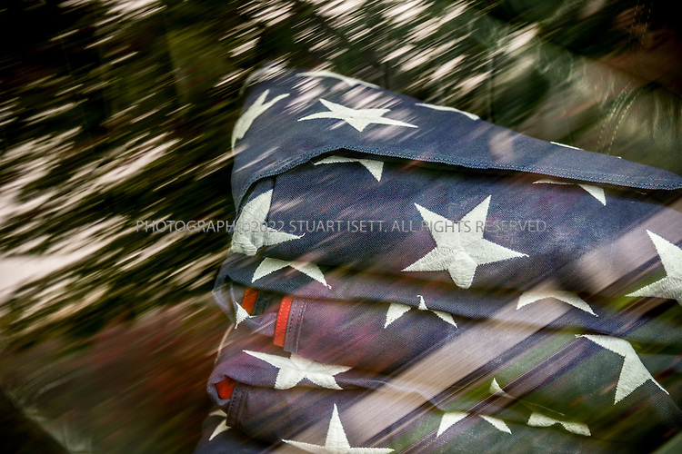 9/30/2016 -- Seattle, WA, USA<br /> <br /> Here: At the Columbia Funeral Home in Seattle,  4 folded US flags await transportation by limousine to the Tahoma National Cemetery.<br /> <br /> James Lindley, 34, an undertaker and US Marine Corp Veteran, works at the Columbia Funeral Home in Seattle, Washington and has taken it upon himself to process the remains of indigent veterans and ensure their remains are placed in Tahoma National Cemetery in nearby Kent, WASH. The veterans are given full military funerals with active service members as well as volunteers who stand-in for unavailable next-of-kin, accepting the folded flags provided by the Veterans Administration.<br /> <br /> On this day, with the help of Mr. Lindley, the remains of 4 veterans were interred at the Tahoma National Cemetery: <br /> <br /> Richard Fesler, born 1951, died2014. US Army Veteran<br /> Rocky Stallone, born 1951, died 2014. Marine Corps veteran<br /> Russell Ristow, born 1944, died 2014. US Army veteran.<br /> Wayne Roberts, Born 1937, died 2014. US Navy veteran.<br /> <br /> <br /> Credit: Stuart Isett for The Wall Street Journal. <br /> VETBODIES<br /> <br /> &copy;2016 Stuart Isett. All rights reserved.