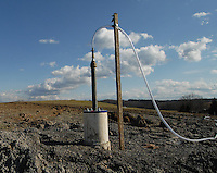 A vent pipe from the Sago mine pokes from a from field Monday, Jan. 9, 2006, near Buckhannon, WV, where investigators are waiting for air to clear in the mine where 12 miners were killed in an explosion last Monday. (Photo by Gary Gardiner)......<br />