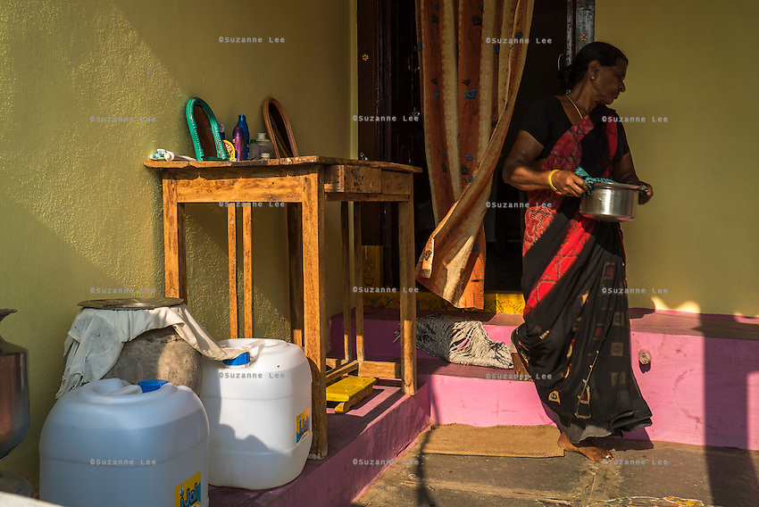 Lakshmi Rayarakula, 65, carries a pot of curry that was made using safe water at their home in Peddapur, a remote village in Warangal, Telangana, India, on 22nd March 2015. Safe Water Network works with local communities that live beyond the water pipeline to establish sustainable and reliable water treatment stations within their villages to provide potable and safe water to the communities at a nominal cost. Photo by Suzanne Lee/Panos Pictures for Safe Water Network