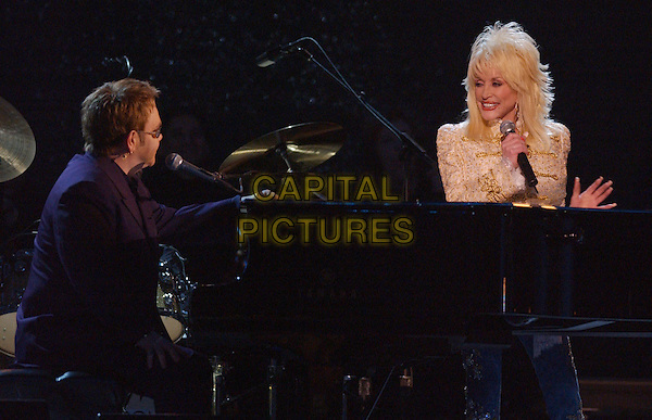 15 November 2005 - New York, New York - Dolly Parton and Elton John. 39th Annual CMA Awards held at Madison Square Garden. Photo Credit: Laura Farr/AdMedia