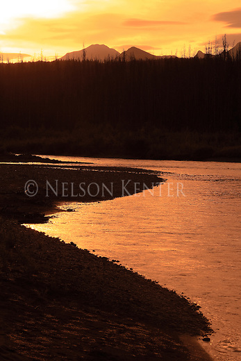 The sun rises on the North Fork of the Flathead River on Glacier National Park's western boundary