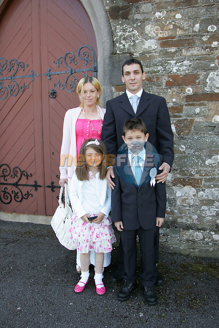 Conor Clarke making his First Communion in Clogherhead on Saturday with his mam and dad Kelly and James, and his sister Ava.